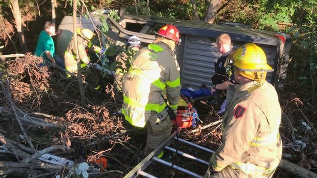2 passengers safe after flipping on I-40 trapping them.