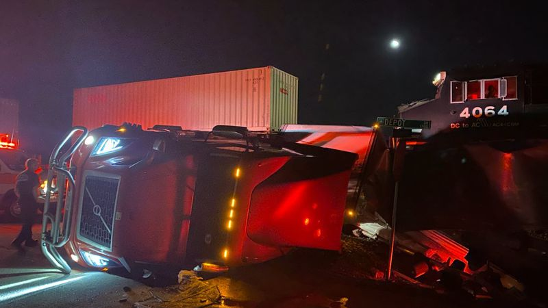 Tractor trailer hit by train on tracks