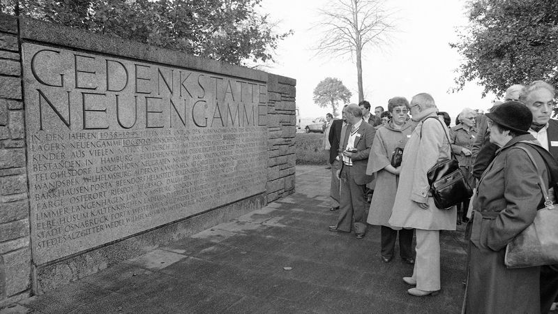 Former French inmates of the Neuengamme Nazi concentration camp arrive at the camp site in...