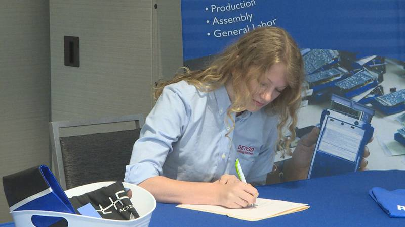 High school students sign onto jobs after graduation
