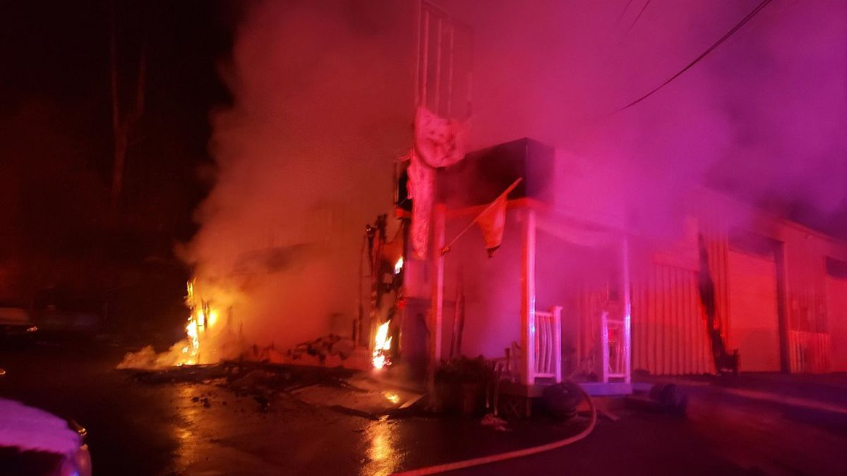 Fire crews knock down fire at auto repair business