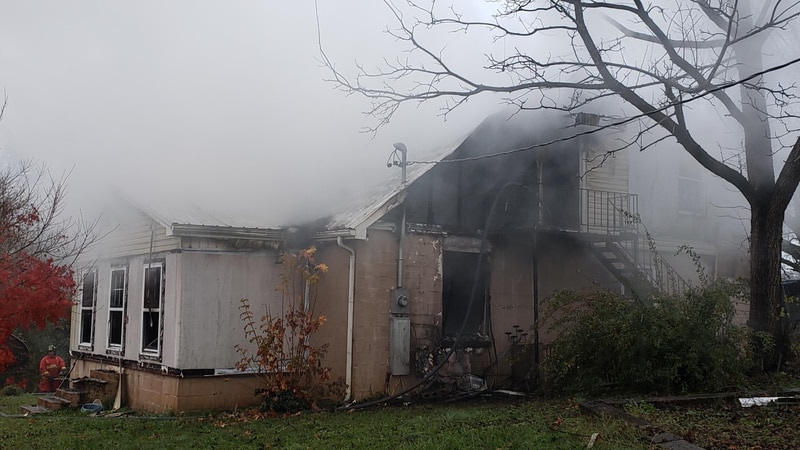 The former home of Melissa Kirby engulfed in smoke.