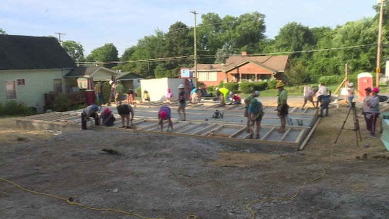 Volunteers and sponsors building a home for Diane Latimore
