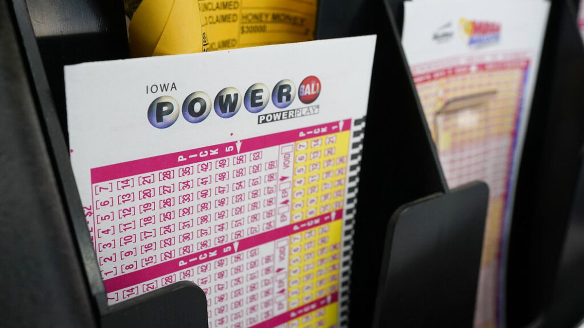 Blank forms for the Powerball lottery sit in a bin at a local grocery store, Tuesday, Jan. 12,...