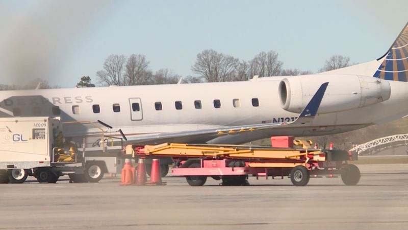 Plane gets unloaded at McGhee Tyson Airport.