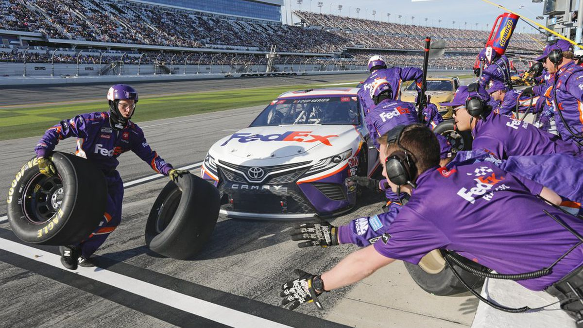 Denny Hamlin's crew changes tires and refuels during a pit stop during the NASCAR Daytona 500 auto race at Daytona International Speedway, Monday, Feb. 17, 2020, in Daytona Beach, Fla. Sunday's race was postponed sue to rain. (AP Photo/Terry Renna)