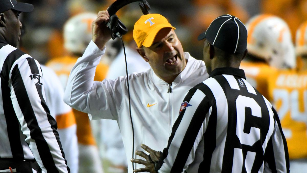 Tennessee head coach Jeremy Pruitt jerks off his headset during a discussion with referees during their 30-7 win over UAB Saturday, Nov. 2, 2019. Michael Patrick/WVLT