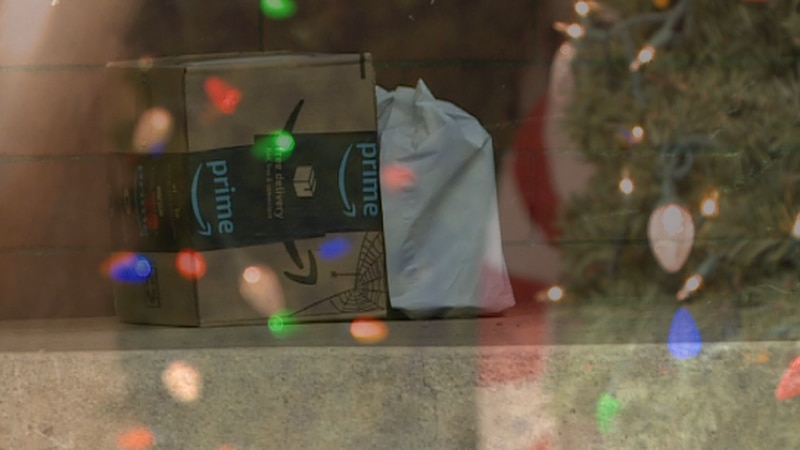 Christmas package sits on a front porch.