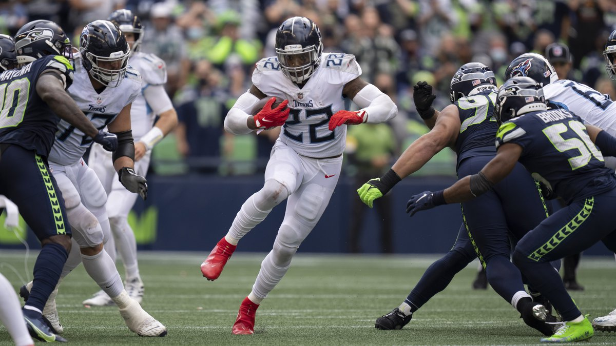 Tennessee Titans running back Derrick Henry runs with the ball during an NFL football game...