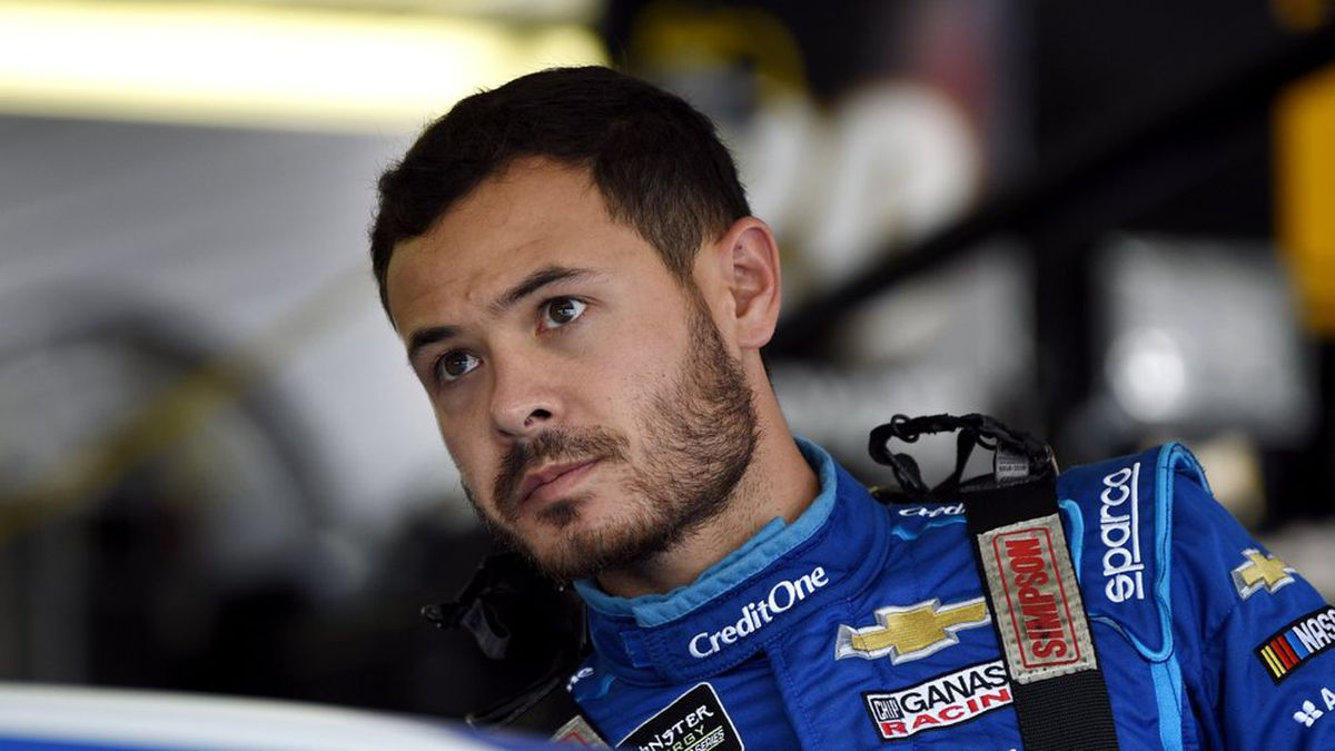 FILE - In this July 27, 2019, file photo, Kyle Larson climbs into his car for a practice session for the NASCAR Cup Series auto race in Long Pond, Pa. Kyle Larson was fired Tuesday, April 14, 2020, by Chip Ganassi Racing, a day after nearly every one of his sponsors dropped the star driver for using a racial slur during a live stream of a virtual race. Larson, in his seventh Cup season with Ganassi and considered the top free agent in NASCAR mere weeks ago, is now stunningly out of a job in what could ultimately be an eight-figure blunder by the star. (AP Photo/Derik Hamilton, File)