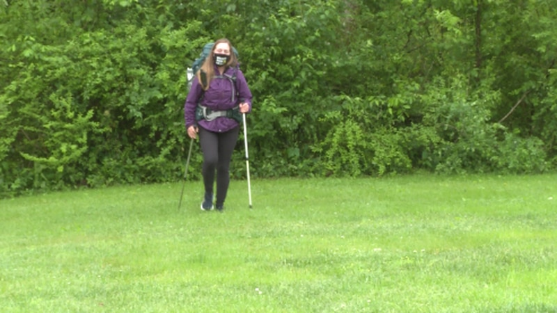 Hannah Bacon walking with her gear in Roane County