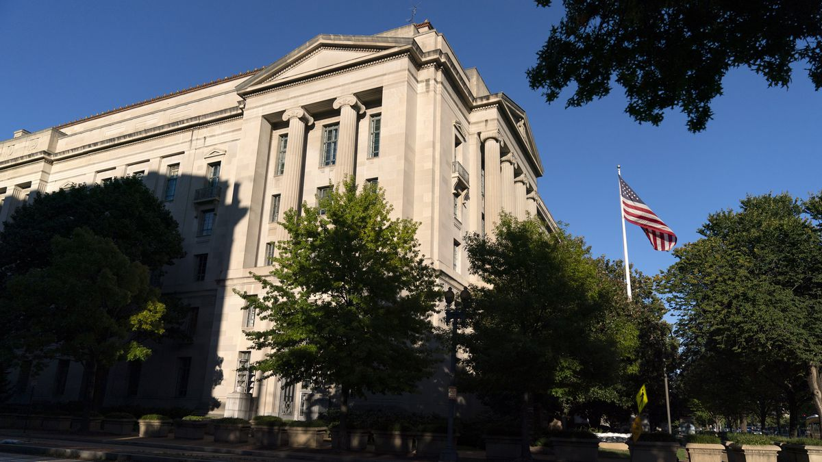 The American flag flies outside of the Justice Department building, Thursday, Oct. 8, 2020, in...
