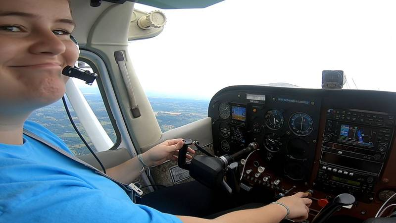 Teen pilot obtaining her license thanks to help with training from a scholarship via the...