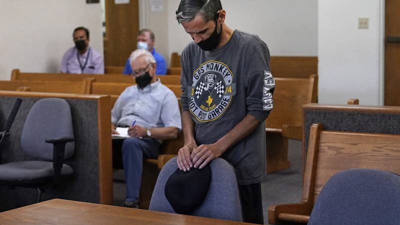 Luis Vertentes, a tenant from East Providence, R.I., stands before Judge Walter Gorman during...