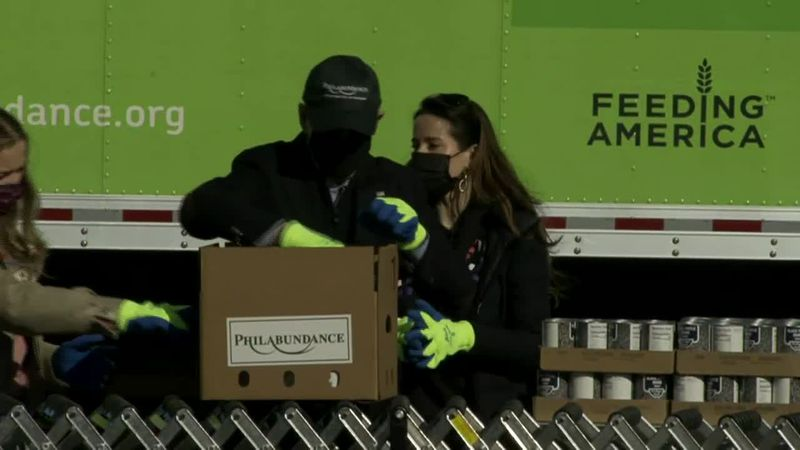 President-elect Joe Biden and members of his family are filling boxes for the needy in...