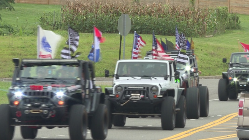 Cars driving in the Jeep ride for Staff Sgt. Ryan Knauss