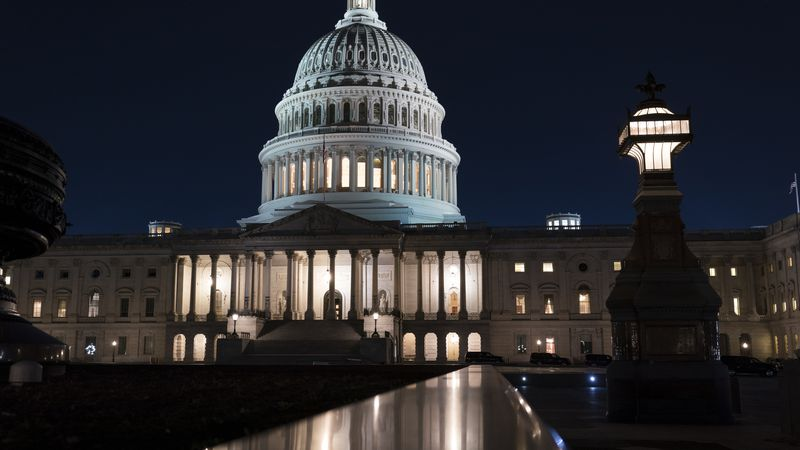 The Capitol is seen at dusk as work in the Senate is stalled on the Democrats' $1.9 trillion...