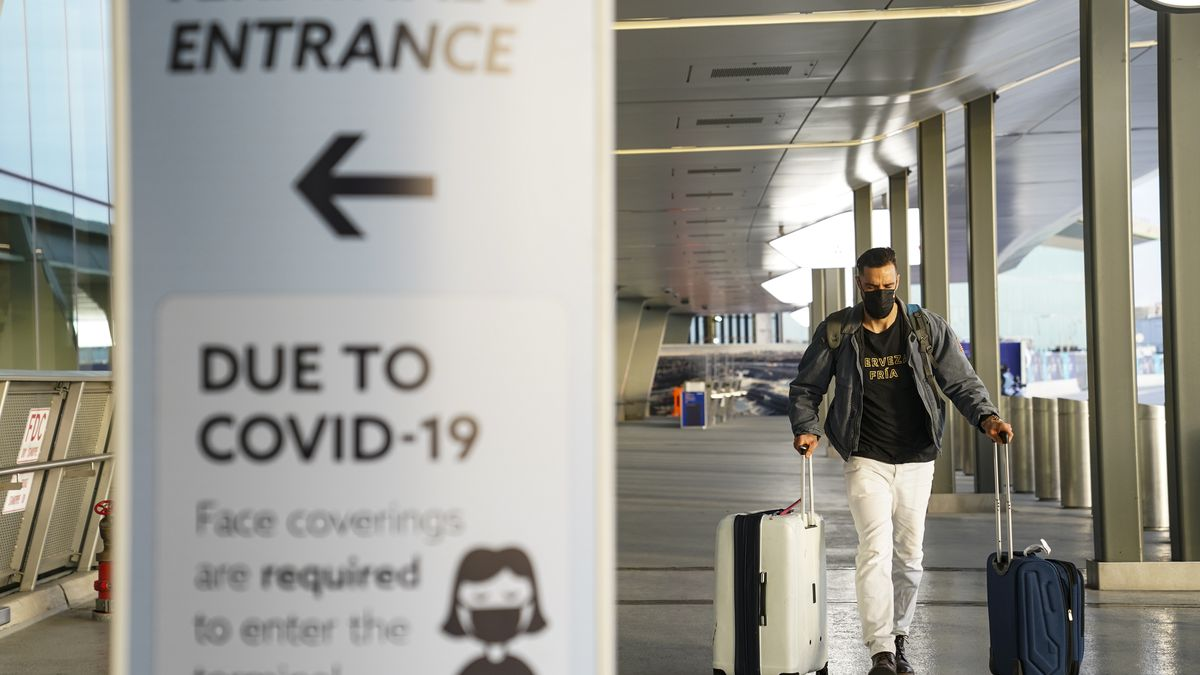 A sign displaying COVID-19 prevention protocols at LaGuardia Airport.