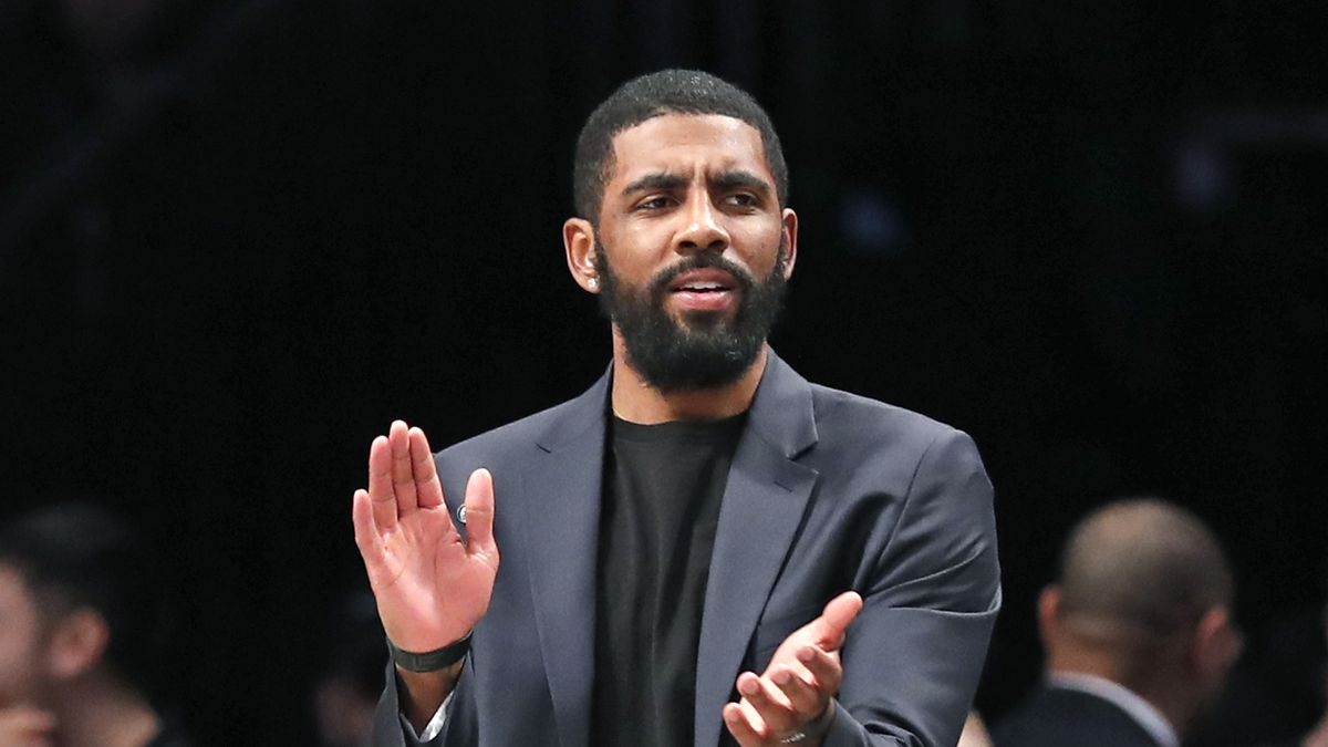 """FILE - In this Tuesday, Jan. 7, 2020, file photo, injured Brooklyn Nets guard Kyrie Irving applauds his teammates from the bench during the first half of an NBA basketball game against the Oklahoma City Thunder, in New York. Irving is joining rapper Common and others for a TV special calling for action following the death of Breonna Taylor. Irving is producing """"#SAYHERNAME: BREONNA TAYLOR,"""" which will debut Wednesday, July 8, 2020, at 7 p.m. EDT on the PlayersTv digital and broadcast network.(AP Photo/Kathy Willens, File)"""