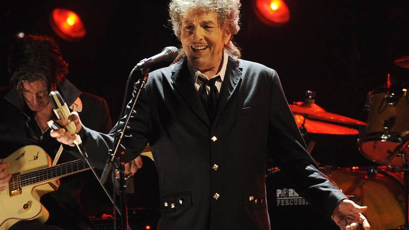 FILE  - In this Jan. 12, 2012, file photo, Bob Dylan performs in Los Angeles. Dylan, who was...