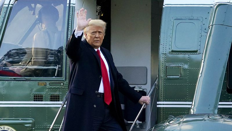 FILE - In this Wednesday, Jan. 20, 2021, file photo, President Donald Trump waves as he boards...
