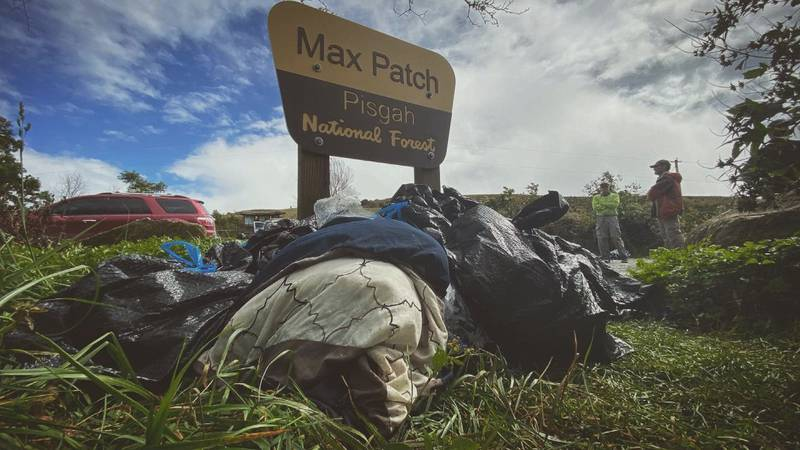 Volunteers collect trash at Max Patch in the Pisgah National Forest.