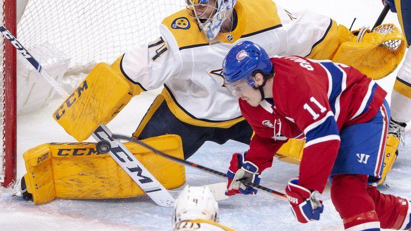 Nashville Predators goaltender Juuse Saros (74) makes a save on Montreal Canadiens right wing...