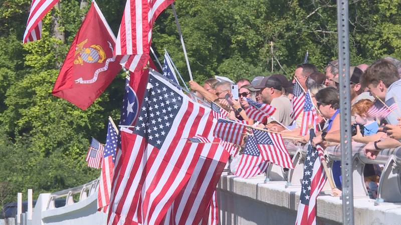 The Maloney Road Bridge was filled with people and American flags