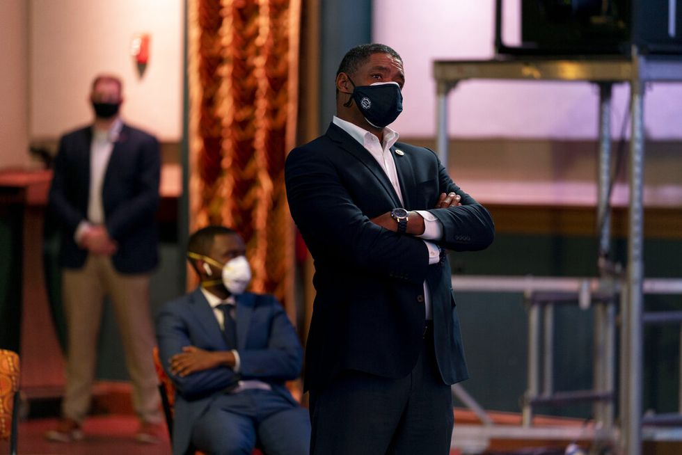 Rep. Cedric Richmond, D-La., right, watches as Democratic presidential candidate former Vice...
