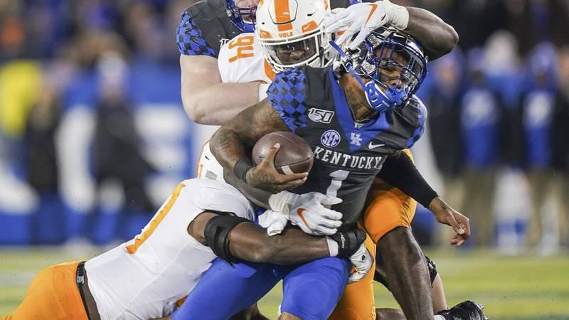 Kentucky quarterback Lynn Bowden Jr. (1) is tackled by Tennessee linebacker Quavaris Crouch...