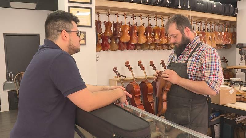 Rule examines a violin