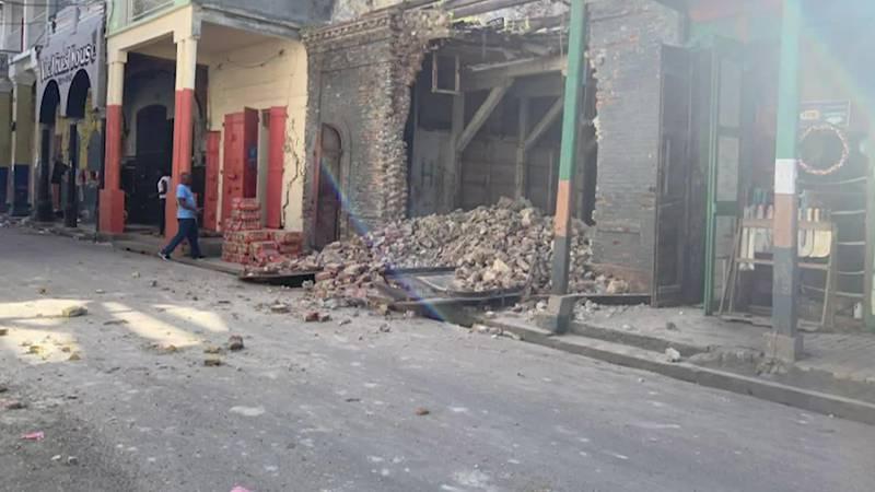 Stills capture the destruction a 7.2 earthquake left in Haiti (Source: JCOM Haiti via CNN...