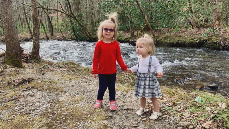 Remi and her sister pose in The Great Smoky Mountains