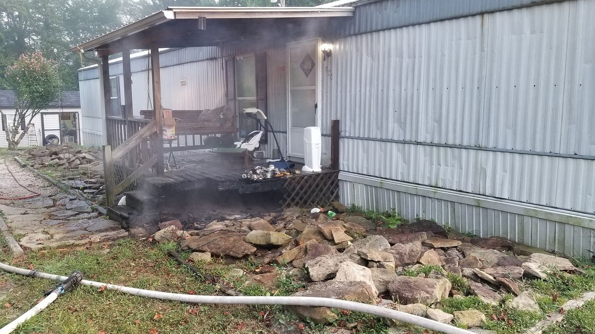 A Kentucky bus driver is being credited for saving a family in a mobile home fire. / Source: (Lee County Emergency Agency)
