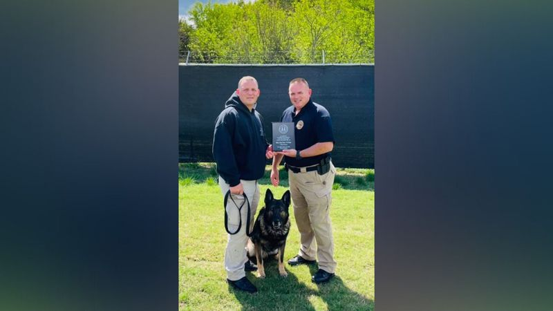 """Sheriff Spangler commended Roky and Deputy Bruce for serving the community with """"pride and..."""