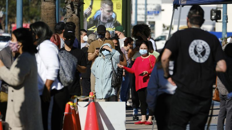 People wait in line to be tested for COVID-19 at a testing site in the North Hollywood section...
