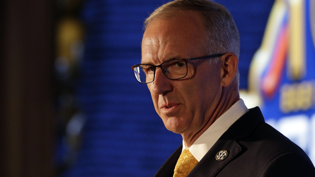SEC Commissioner Greg Sankey speaks to reporters during the NCAA college football Southeastern...