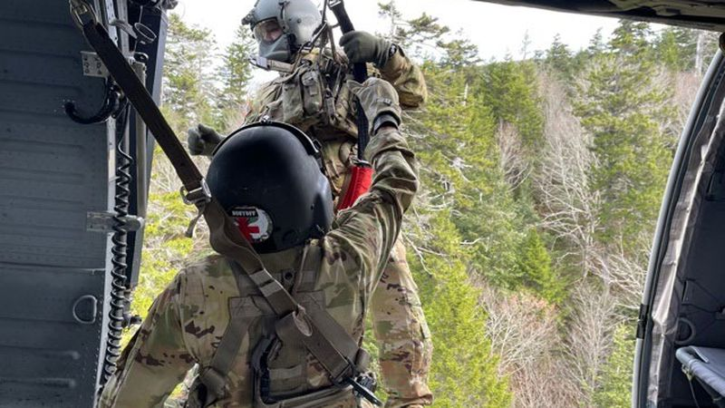 Spc. Joshua Culotta begins hoist operations and lowers Sgt. 1st Class Giovanni DeZuani to a...