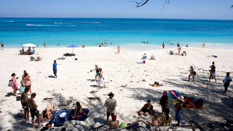 FILE - In this Sept. 6, 2008, file photo, visitors are shown sunbathing along the beach in...