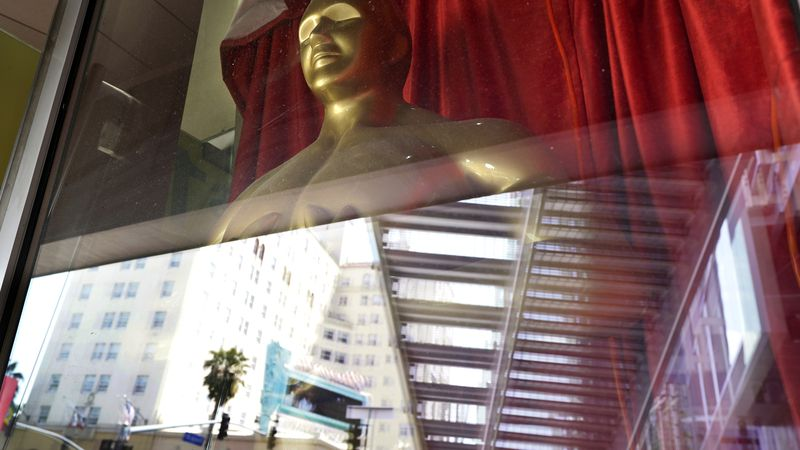 A fake Oscar statue is pictured in the window of a gift shop on Hollywood Blvd., Thursday,...