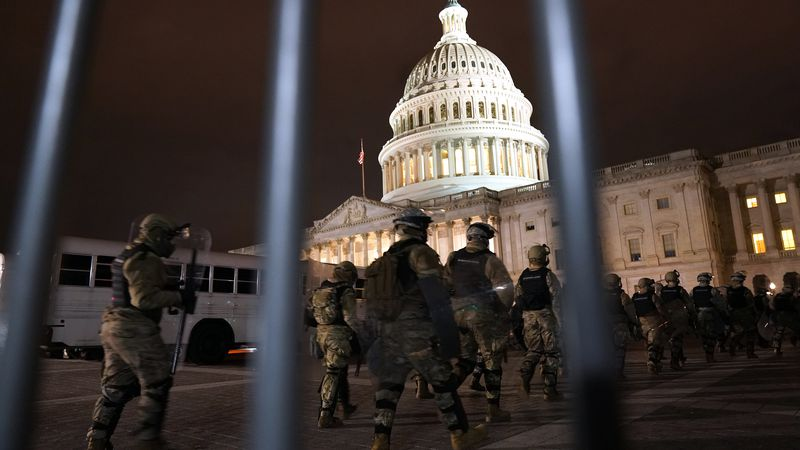 Members of the National Guard arrive to secure the area outside the U.S. Capitol, Wednesday,...
