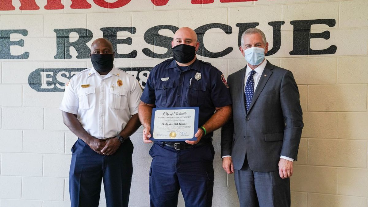Clarksville Mayor Joe Pitts and Fire Chief Montgomery Jr. recognized Nick Greene for saving a man from a burning building, CBS affiliate WTVF reported.